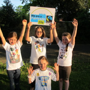 Here are 4 of the winners of our Fairtrade T-shirt competition, wearing T-shirts with their own designs. Congratulations to  L to R Aine Kelly, Alice Garth Cameron, Josey Eard and below, Maddie Plant. We would like to thank all the 315 young people who entered the competition, we were impressed with all the great ideas and designs.